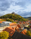 Top view over Wernigerode town with a medievel cas. Wide angle picture taken from the top of a town church on a cloudy Autumn day. Wernigerode, Saxony-Anhalt Royalty Free Stock Photo