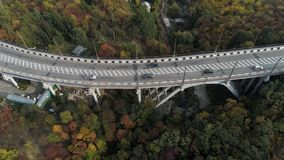 Top view on overpass with driving cars, sea and beautiful landscape background. Aerial view of highway and overpass in stock photos