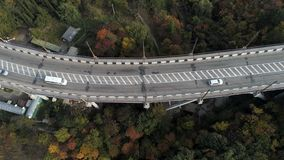 Top view on overpass with driving cars, sea and beautiful landscape background. Aerial view of highway and overpass in royalty free stock photo