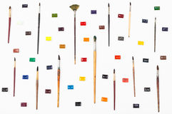 Top view of paint brushes and watercolors arranged Stock Photos