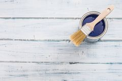 Top of view paint can with blue color and brush on table royalty free stock images