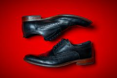 Pair of male shoes on a red background Stock Images