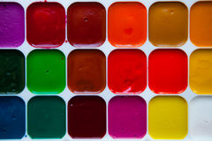 Top view palette of watercolor paints in box isolated on white b. Top view of watercolor paints in box isolated on white background, close up Royalty Free Stock Images