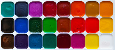 Top view palette of watercolor paints in box  on white b. Top view of watercolor paints in box  on white background, close up Royalty Free Stock Image