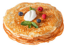 The top view on pancakes with holes. Made of yeast dough. Decorated with sour cream, mint and fresh Stock Photos