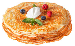 The top view on pancakes with holes. Made of yeast dough. Decorated with sour cream, mint and fresh Royalty Free Stock Images