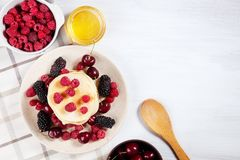 Top view Pancakes with honey syrup and berry for breakfast. Food for breakfast. Copy space for design. homemade american pancakes stock photo