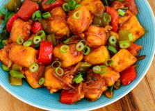 Top view -Paneer Manchurian in bowl. Indo-Chinese starter -Paneer Manchurian,spiced cottage cheese cooked in fusion with Chinese soy and sweet chilli sauces Royalty Free Stock Image