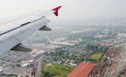 Top view  panorama of Bangkok under aircraft's wing Royalty Free Stock Image