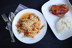 Top view Papaya salad with chicken grilled and sticky rice Stock Image