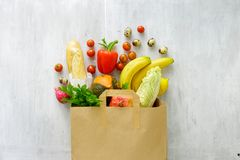 Top view paper bag of different fresh health food. Paper bag of different fresh health food, top view Royalty Free Stock Photography