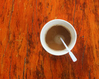 Top view of a paper cup of coffee on wooden table Stock Photography