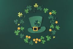 Top view of paper decoration of green hat and shamrock for st patricks day. Isolated on green Royalty Free Stock Images