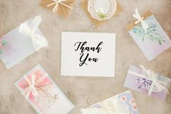 Top view of paper with lettering surrounded with greeting cards. On concrete surface royalty free stock photo