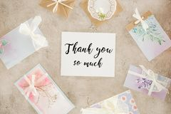 Top view of paper with thank you lettering surrounded with greeting cards. On concrete surface Royalty Free Stock Image