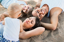 Top view on  parents with kids relaxing on beach Royalty Free Stock Photo
