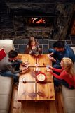 Top view of parents playing cards with kids royalty free stock photo