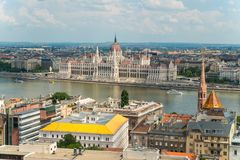 Top view on a Parliament and Buda and Pest banks from Fisherman`. View from Fisherman`s Bastion, located at the heart of Buda`s Castle District, on a Parliament royalty free stock photo