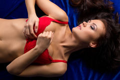 Top view of passionate underwear model lying Royalty Free Stock Image