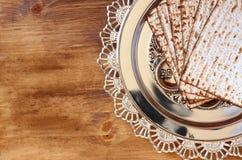 Top view of passover background. matzoh (jewish passover bread) over wooden background Stock Images