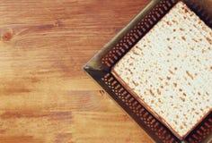 Top view of passover background. matzoh (jewish passover bread) over wooden background Stock Photos