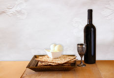 Top view of passover background. matzoh (jewish passover bread) and traditional sedder plate over wooden background Royalty Free Stock Image