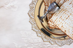 Top view of passover background. matzoh (jewish passover bread) and traditional sedder plate over wooden table Royalty Free Stock Image