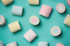 Top view of pastel colored marshmallow on a blue background. Min. Imalism style Stock Photos