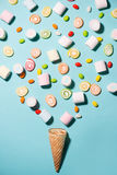 Top view of pastel colored marshmallow and sweet candy in a waffle cup, waffle cones with candy stock photography