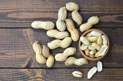 Top view of peanuts in the bowl. Top view of peanuts in the wooden bowl Royalty Free Stock Photos
