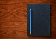 Pencil with notebook Royalty Free Stock Photo