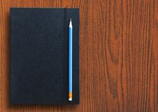 Pencil with notebook Royalty Free Stock Image
