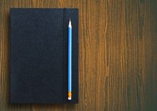 Pencil with notebook Stock Photo