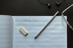 Music notes writing composer creating musician art. Top view of the pencil, eyeglasses and eraser laying near to the sheet notes with handwritten notes. The stock image