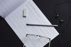 Music notes writing composer creating musician art. Top view of the pencil, eyeglasses and eraser laying on the sheet notes with handwritten notes. The concept royalty free stock photos
