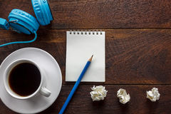 Top view pencil,note paper,crumpled paper black coffee,headphone stock photos