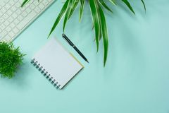 Top view of pencil with other supplies and notebook on blue back Royalty Free Stock Image