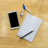 Top View Pencil with paper and book on wooden table royalty free stock images