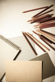 Top-view of pencils and paper sheets Stock Photos