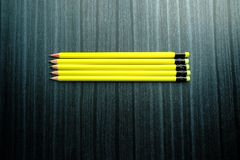 Top view of pensil on wooden background Royalty Free Stock Images