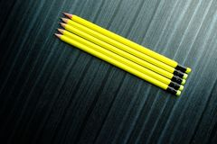 Top view of pensil on wooden background Stock Photos