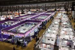 Top view of people and booths at Mido 2014 in Milan, Italy Stock Photography
