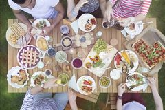 Top view on people eating food during grill party in the garden stock image