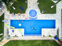 Top view of people enjoying the swimming pool Stock Photo
