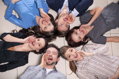 Top view of people laying in circle together. Stock Image