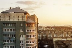 Top view of the people relax on the roof of a multistory building. The roof of a multi-storey building. Sunny sunset. View of the. The roof of a multi-storey royalty free stock image