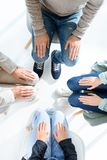 Group therapy session. Top view of people sitting with hands in knees at group therapy session royalty free stock images
