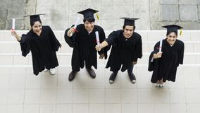 Top view of people students with the Graduation gowns and hat Royalty Free Stock Photography