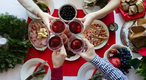 Top view of people toasting with glasses of red wine stock image