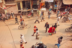 Top view on people walking and cyclists riding on busy street of indian city Royalty Free Stock Images